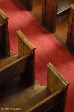 [Mead Chapel side aisle, red carpet, and pews.]