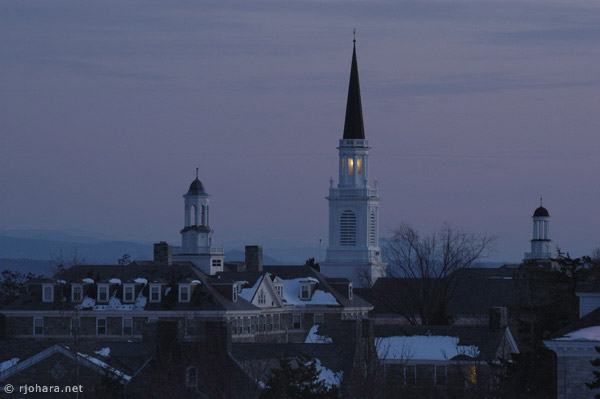[Sunset view of the Mead Chapel steeple at Middlebury College.]