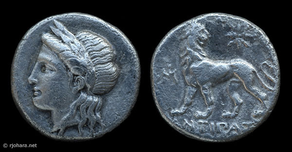 [Image: Silver head-of-Apollo coin from ancient Miletus.]