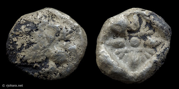 [Image: Ancient counterfeit or fourree of a silver coin of Miletus (1/12th stater, lion-sun type).]