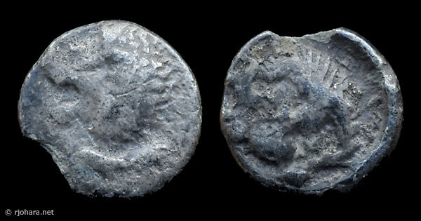 [Image: Small silver ancient coin of Miletus or Mylasa, lion head/lion scalp type.]