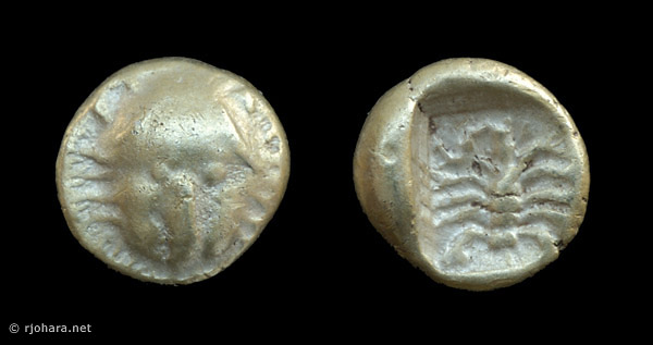 [Image: Electrum lion/scorpion coin of ancient Asia Minor.]