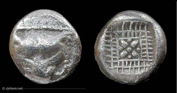 [Image: Silver lion-mask coin from ancient Greece.]