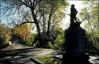 [Image: Massachusetts Minuteman statue at the North Bridge, Concord.]