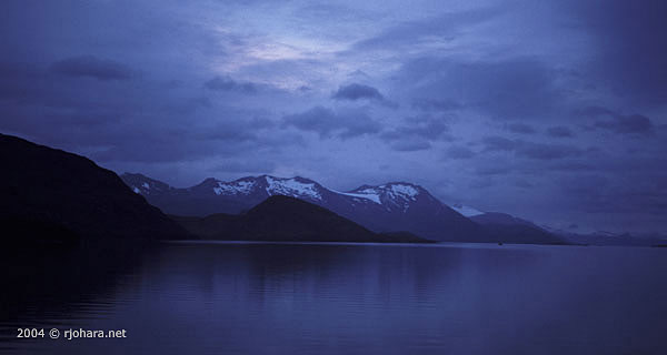 [A blue twilight aboard ship in the fiords of southern Chile.]