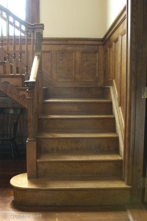 [Sunlit stairs to the south gallery in Mead Chapel.]