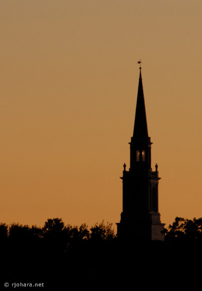 [Mead Chapel steeple at dusk on the Middlebury College campus.]
